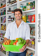 Man With Vegetable Basket In Supermarket