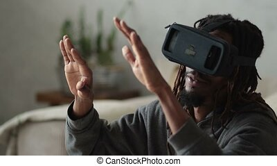 Man with virtual reality headset playing video games