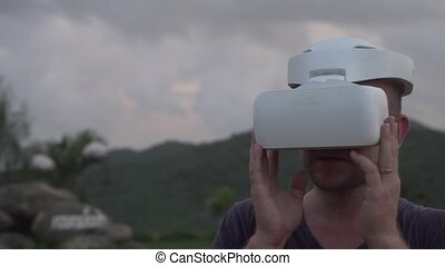 Man with VR glasses at the tropical viewpoint - Man at the ...