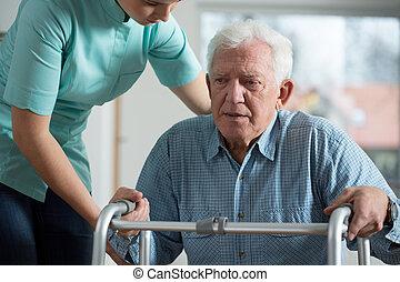Man with walker - Close-up of afraid elderly man with walker...