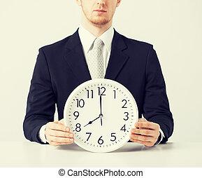 man with wall clock - close up of man holding wall clock