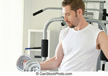 man with weight training equipment