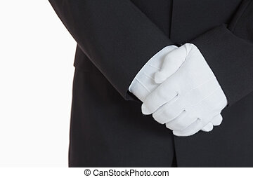 Man with white gloves - close-up standing man with white...