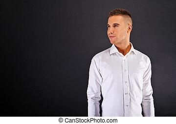 Man with white shirt over dark background