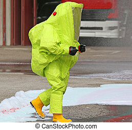 man with yellow protective gear against biological risk