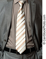 man without head in a business suit on white background