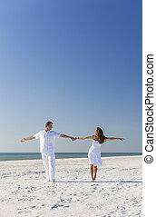 Man Woman Couple Dancing on Empty Beach - Middle aged happy...