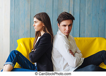 man woman on yellow sofa