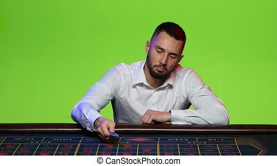Man won by putting the last chip on the black - Man dressed...