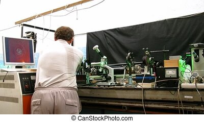 Man work in physics lab, time lapse - Man work in physics...
