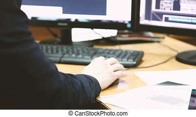 man work on computer with two monitors.
