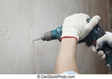 hammer drills wall - man worker hammer drills wall