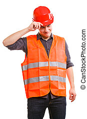 Young man construction worker builder foreman in orange safety vest and red hard hat isolated on white. Safety in industrial work. Studio shot.