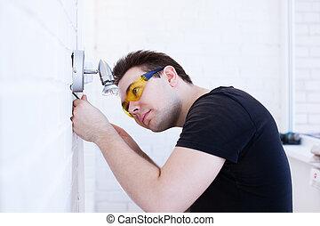 Man worker installing lamp
