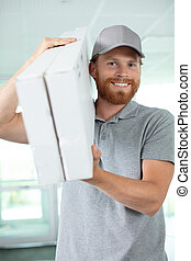man worker is carrying a box