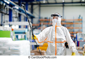 Man worker with protective mask and suit disinfecting ...