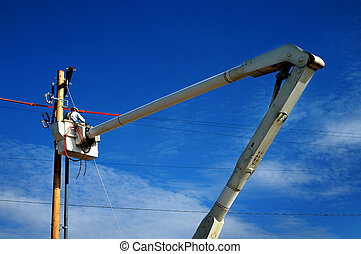 Man Worker Working on Power Lines Crane Bucket High in the ...