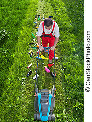 Man working against nature - concept with plastic spewing lawn mower
