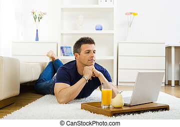 Man working at home - Casual young man working at home on...
