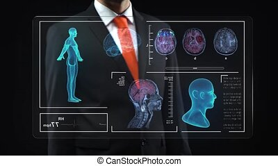 Man working at technological medical digital holographic monitor, human hologram. Man in black suit with red cravat on dark bakground. Concept futuristic medicine, doctors, laboratory, future, science
