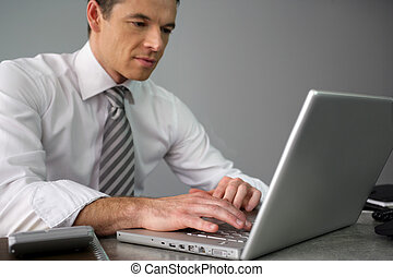 Man working away at his desk