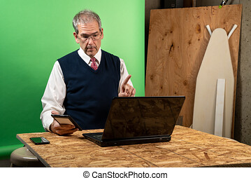 Man working from home in his basement on a virutal meeting.