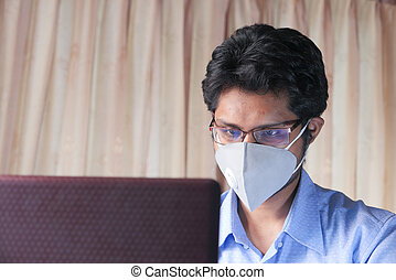 Man working from home. Using laptop.