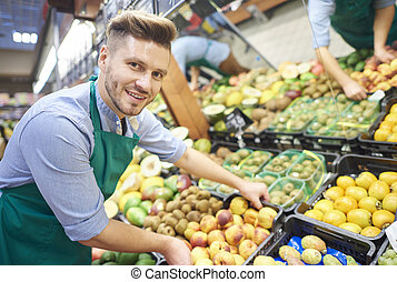 Man working hard in supermarket