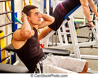 Man working his abdominal crunches on bench