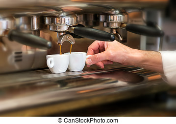 Man working in a coffee house preparing espresso