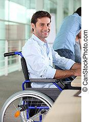 Man working in a wheelchair