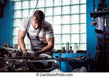 Man working in car workshop