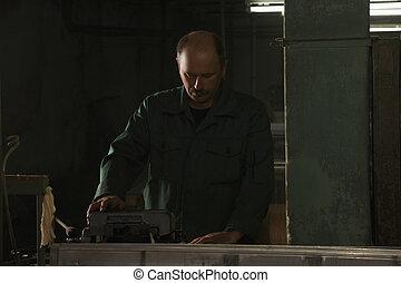 Man working in dark factory