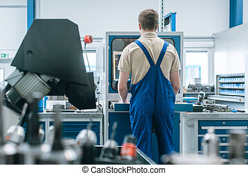 Man working in factory on semi automatized production line