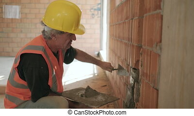 Man Working In New Building With Bricks Equipment Cement -...