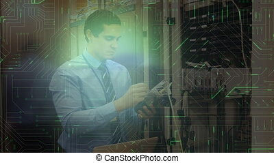 Man working in server room and glowing circuit board