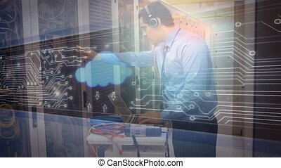 Man working in server room with cloud icon and glowing circuit board