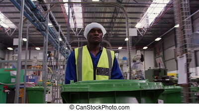 Man working in warehouse - Front view of focused African ...