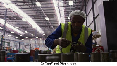 Man working in warehouse - Front view of focused mixed race ...