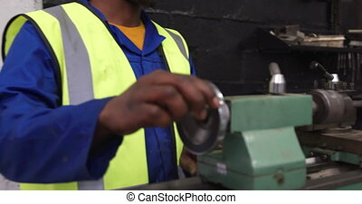 Man working in warehouse - Side view of focused mixed race ...