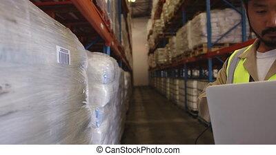 Man working in warehouse using barcode scanner 4k