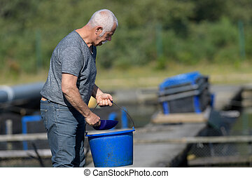 man working on a fish farm