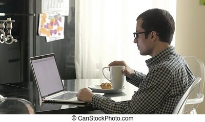 Man Working on a Laptop Computer is Alone