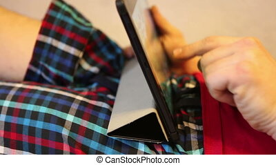 man working on a tablet computer