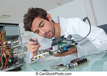 Man working on computer component
