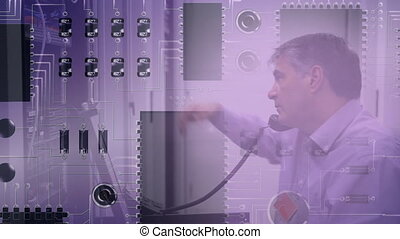 Man working on computer server while circuit board moves in foreground