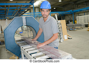 Man working on factory production line
