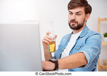 Man working on laptop and drinking beverage - I almost...
