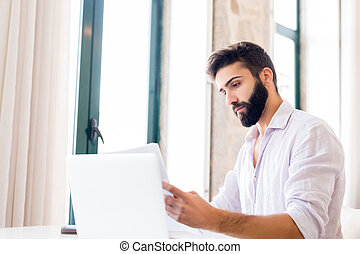 Man working on laptop from home