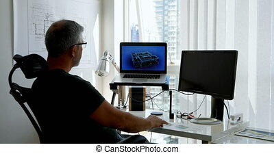 Man working on laptop on desk 4k